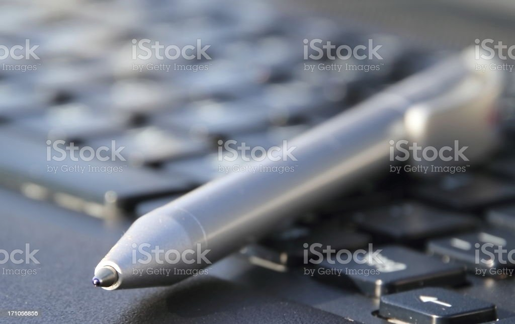 silver pen on the laptop stock photo