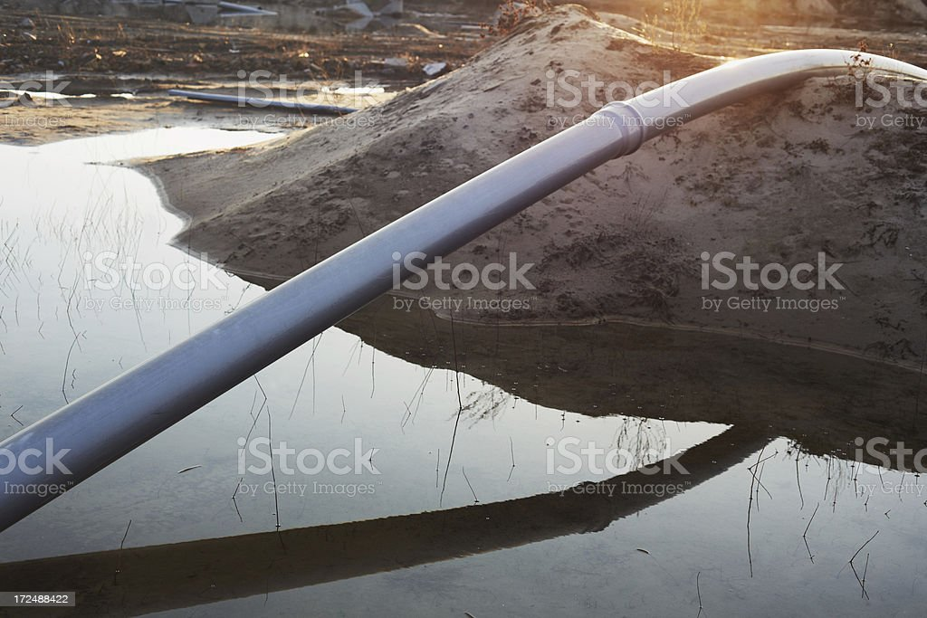 Silver pipe at sunset. royalty-free stock photo
