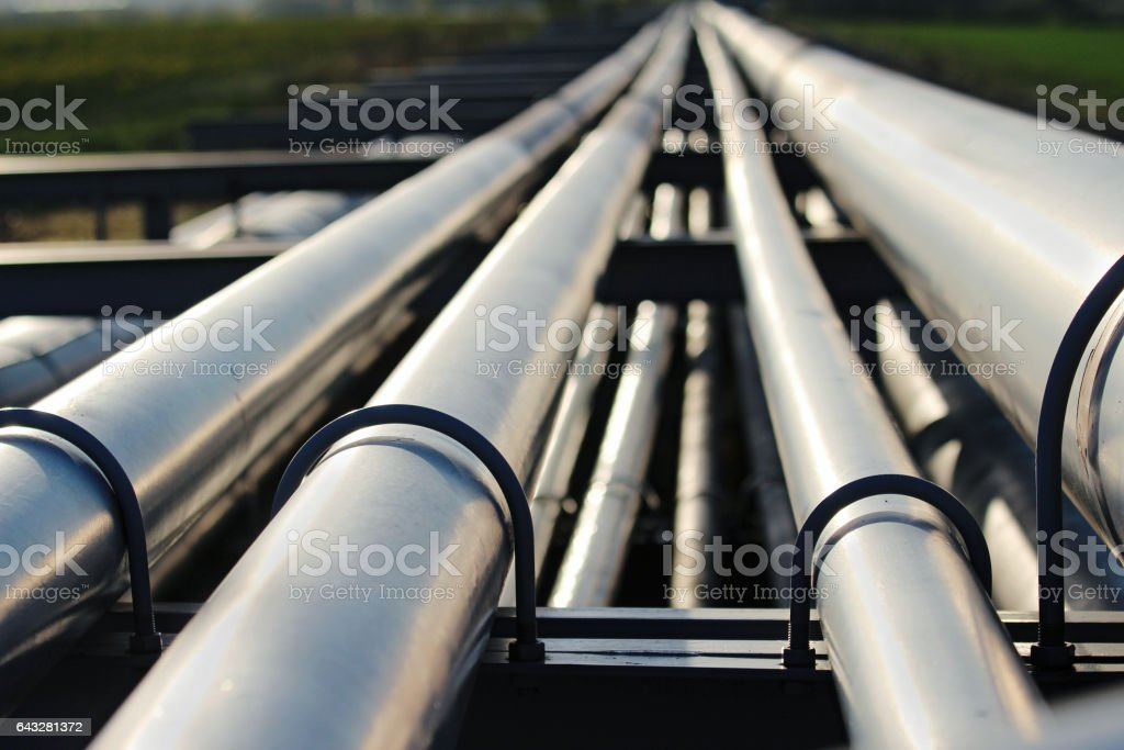 silver pipeline system in crude oil factory stock photo