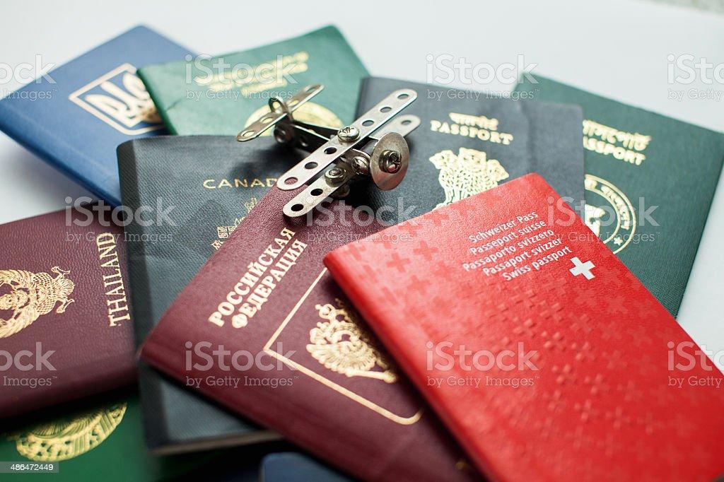 Silver plane landed on passports stock photo