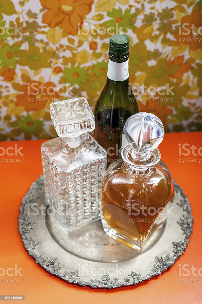 Silver Plate with Alcohol Bottles Downward Angle Floral Wallpaper royalty-free stock photo