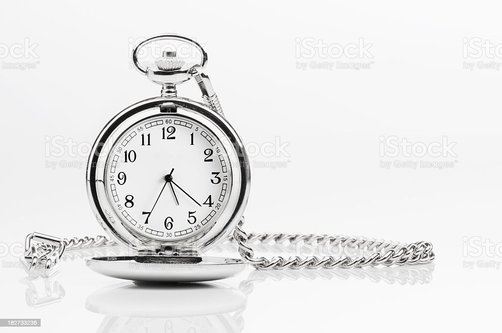 Silver pocket watch and chain on a white background stock photo