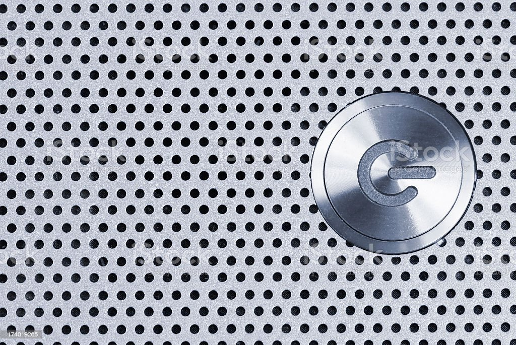 Silver power button icon on spotted background royalty-free stock photo
