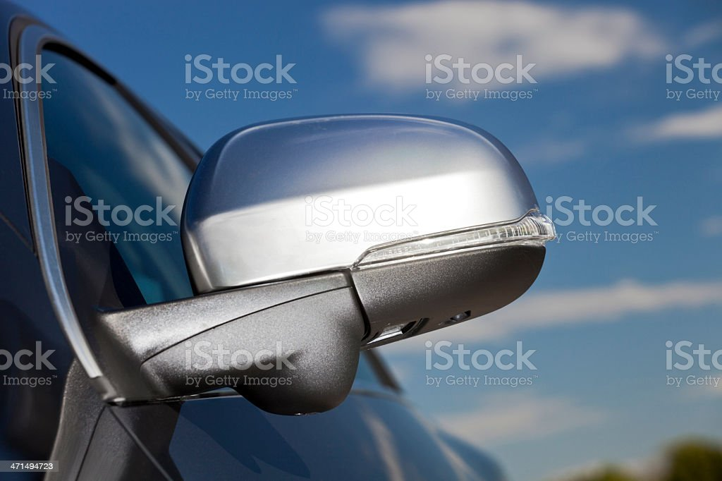 Silver rear view mirror on a black car royalty-free stock photo