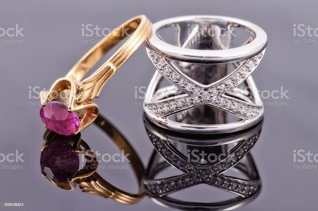 silver ring and a thin gold ring with ruby stock photo