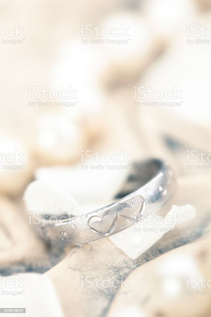 Silver Ring and flower petals. stock photo