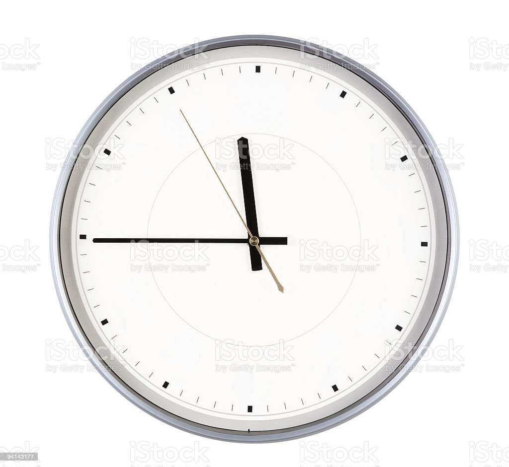 Silver Round Clock displaying 11:45 stock photo