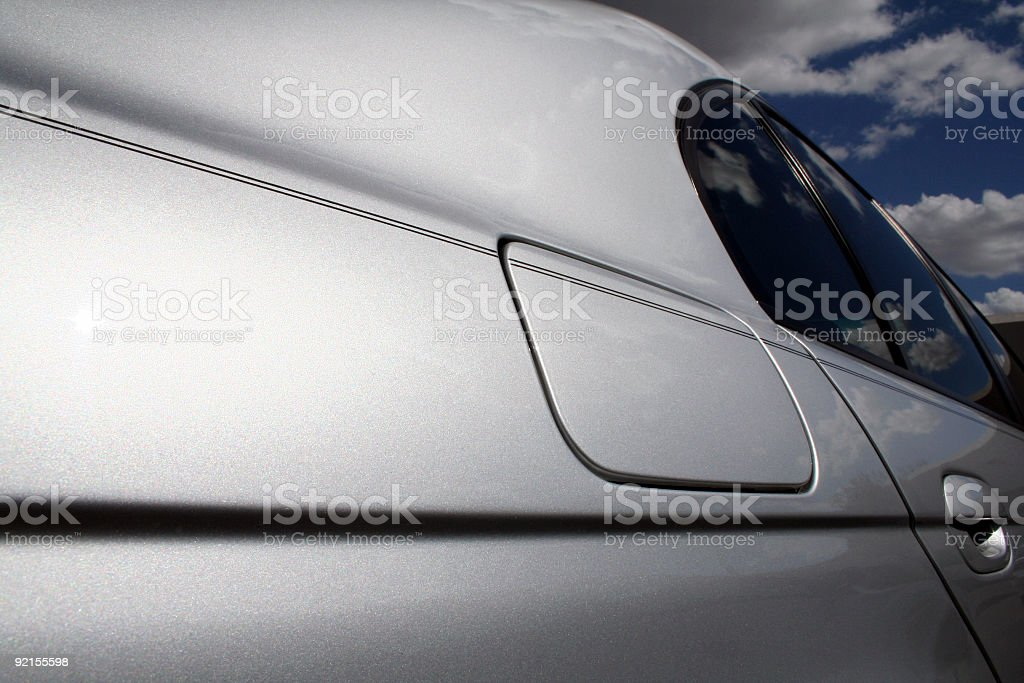 Silver Sedan from the side rear royalty-free stock photo
