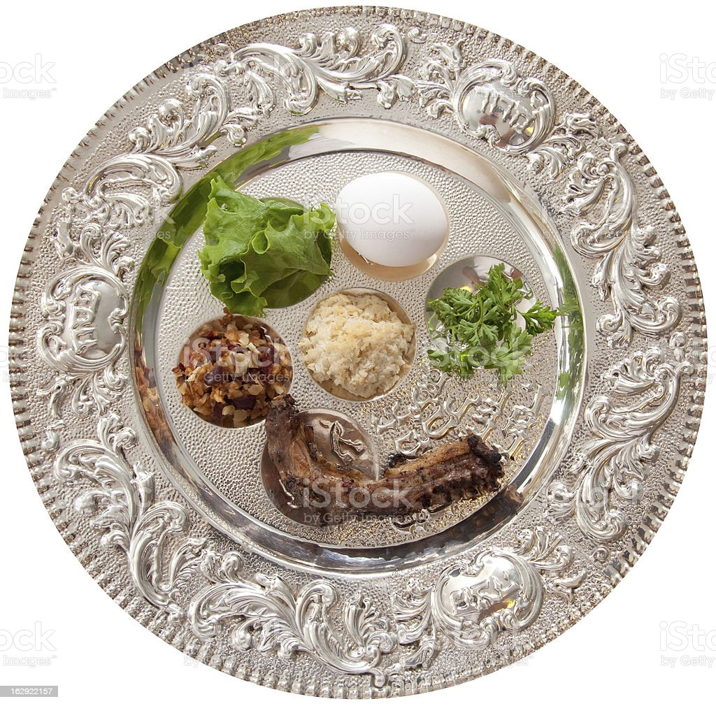 Silver Sedar plate with egg, parsley, lettuce, meat stock photo