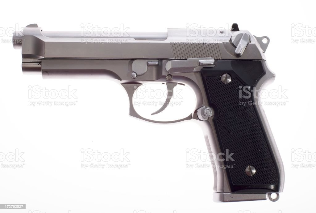 A silver semi auto handgun on white background stock photo