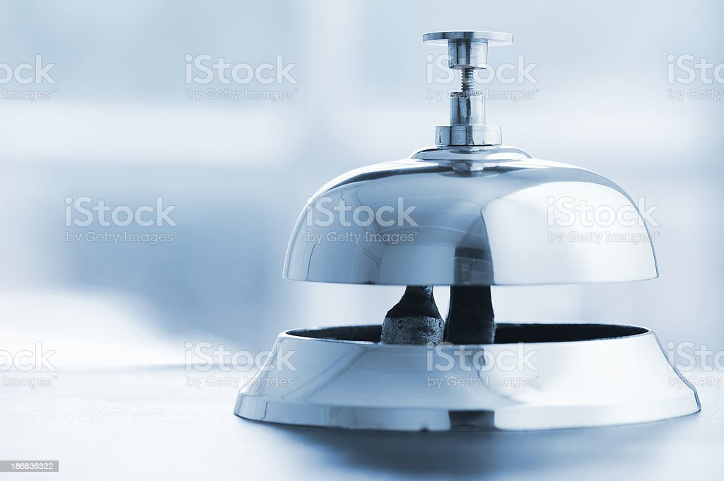 Silver service bell on a desk with copy space royalty-free stock photo