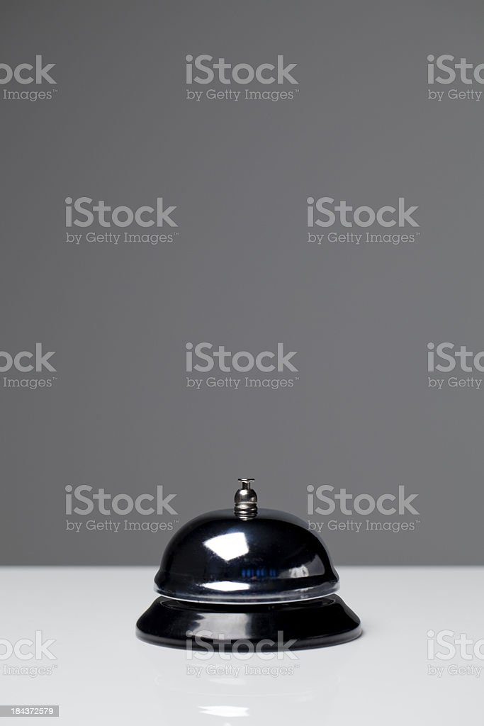 A silver service bell sitting on a counter. royalty-free stock photo
