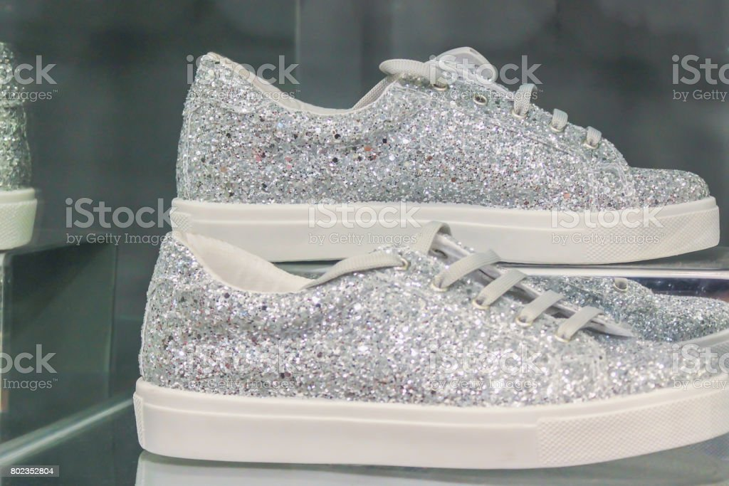 Silver sneakers stock photo