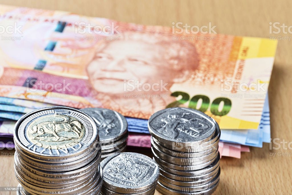 Silver South African coins with new Mandela banknotes stock photo