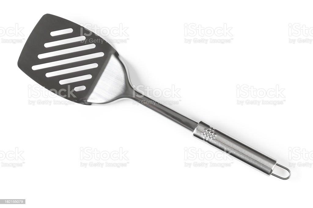 A silver spatula angled diagonally  royalty-free stock photo