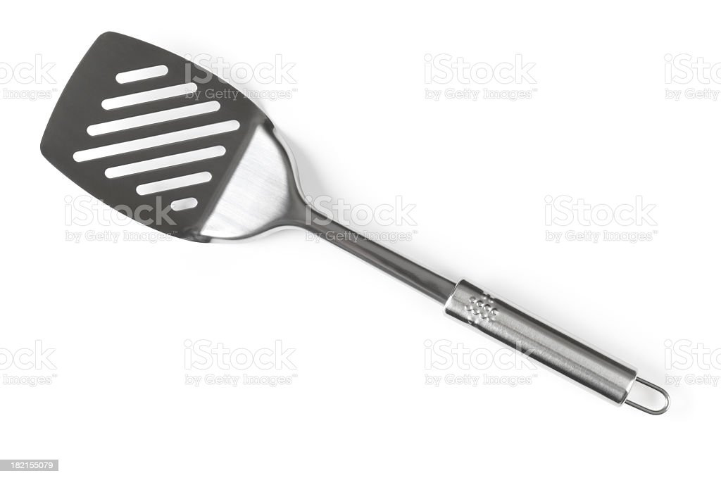 A silver spatula angled diagonally  stock photo