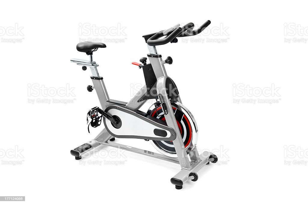 Silver spin bike isolated on a white background stock photo