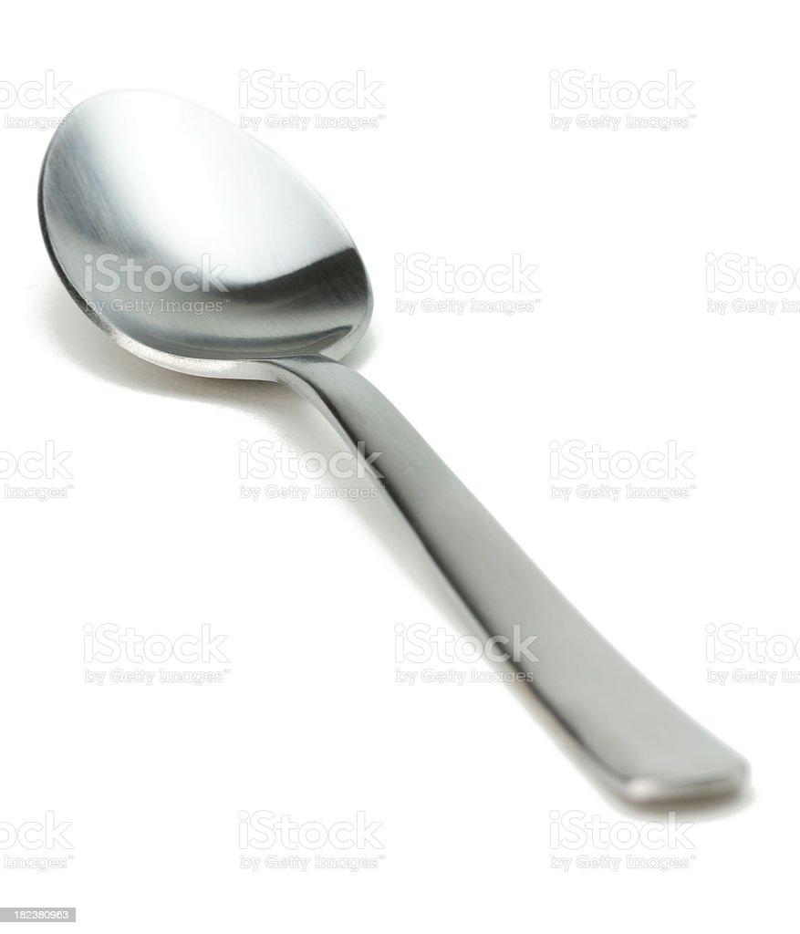 Silver spoon against white background  stock photo