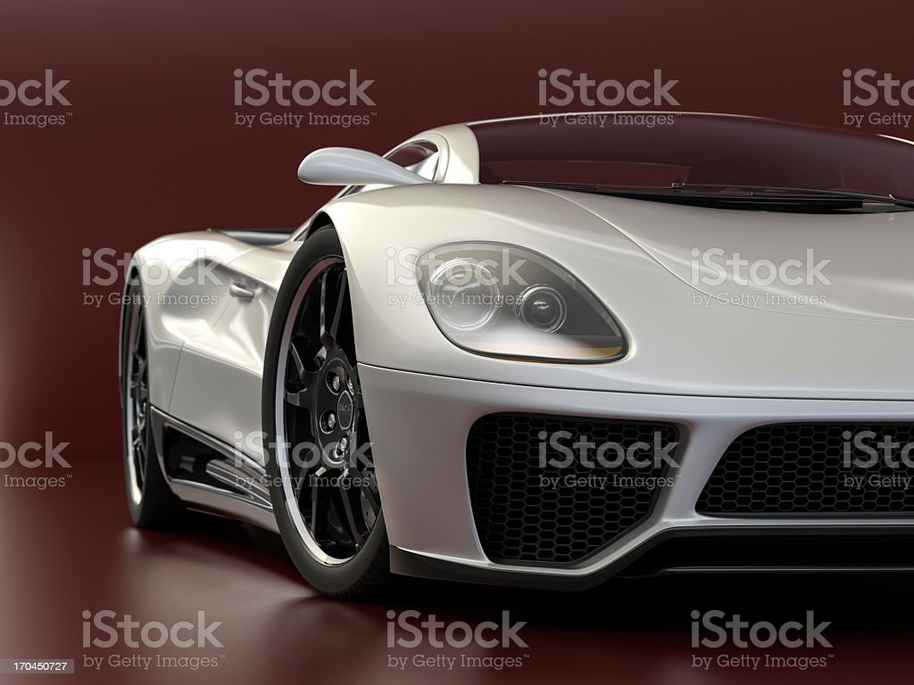 A silver sports car on a red background stock photo