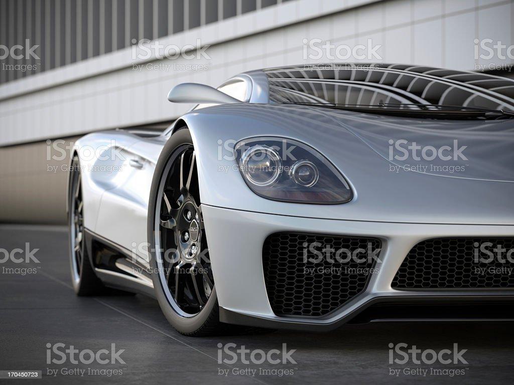 A silver sports car on black tile floor stock photo