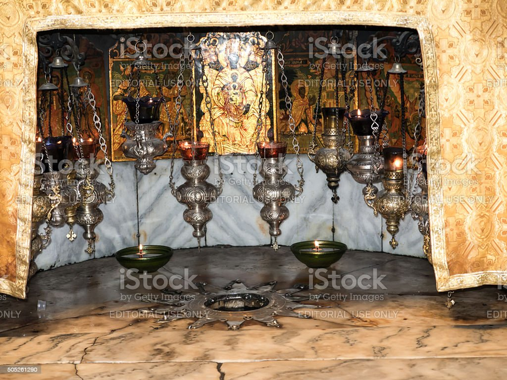 Silver star marks the traditional site the birth of Jesus stock photo