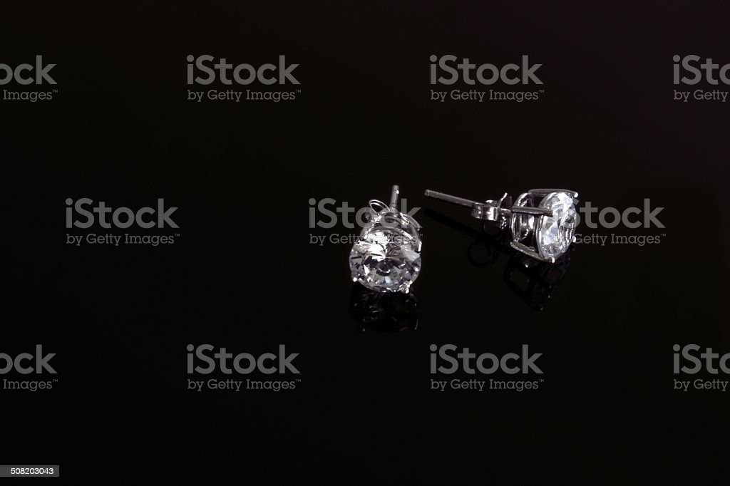 Silver stud diamond earrings stock photo