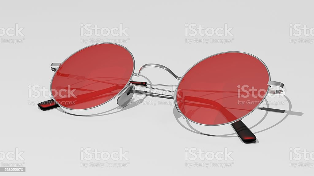 Silver sunglasses with red lenses isolated on a white background stock photo