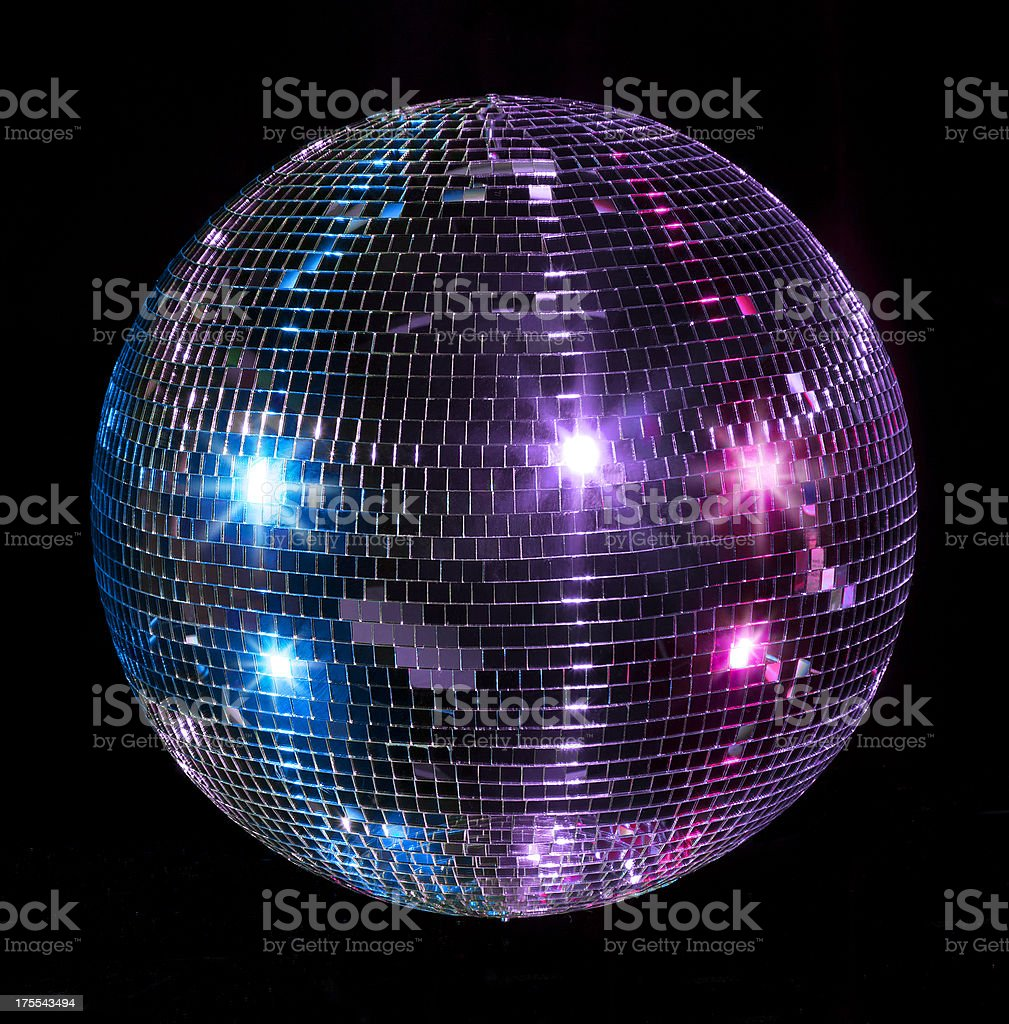 A blue purple and pink lit disco ball isolated on a black background.