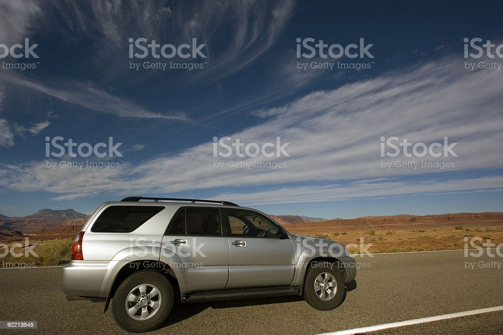 Silver SUV driving in Utah. stock photo