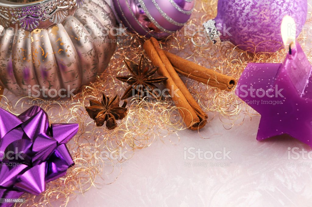 silver tea light and purple Christmas ornament with copy space royalty-free stock photo