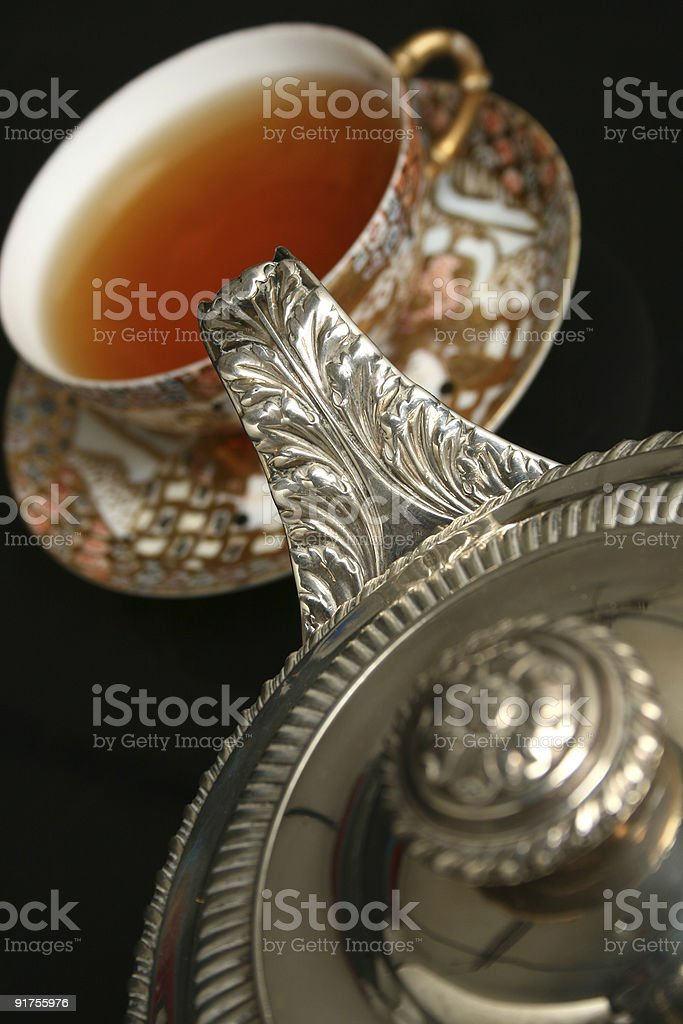 Silver teapot pouring tea royalty-free stock photo