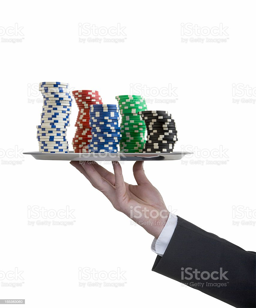 Silver tray with butler's hand and poker chips stock photo
