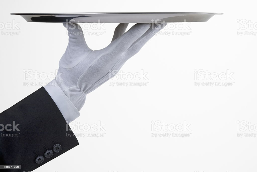 Silver tray with hand stock photo