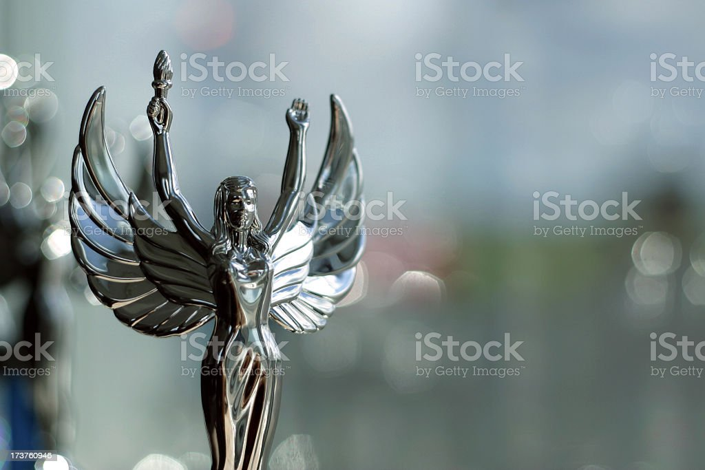 A silver trophy of a winged woman with her hands in the air royalty-free stock photo