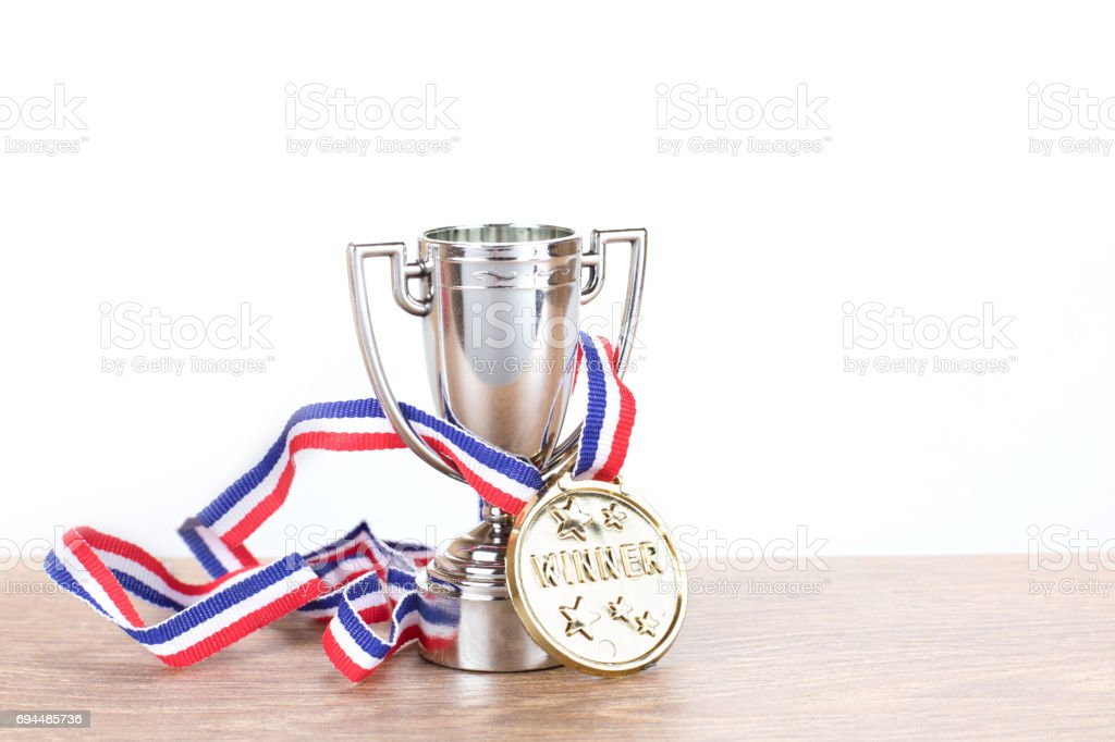 Silver trophy with gold medallion on a ribbon stock photo