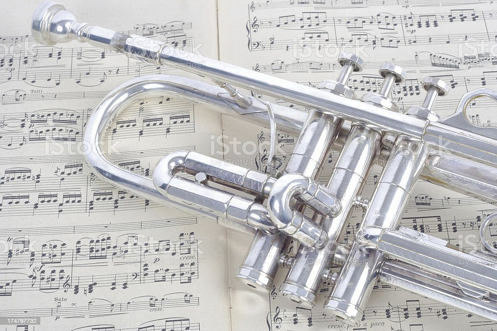 silver trumpet and old sheet music stock photo