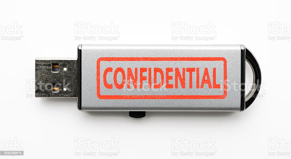 Silver USB Flash Drive with Confidential data on white background stock photo