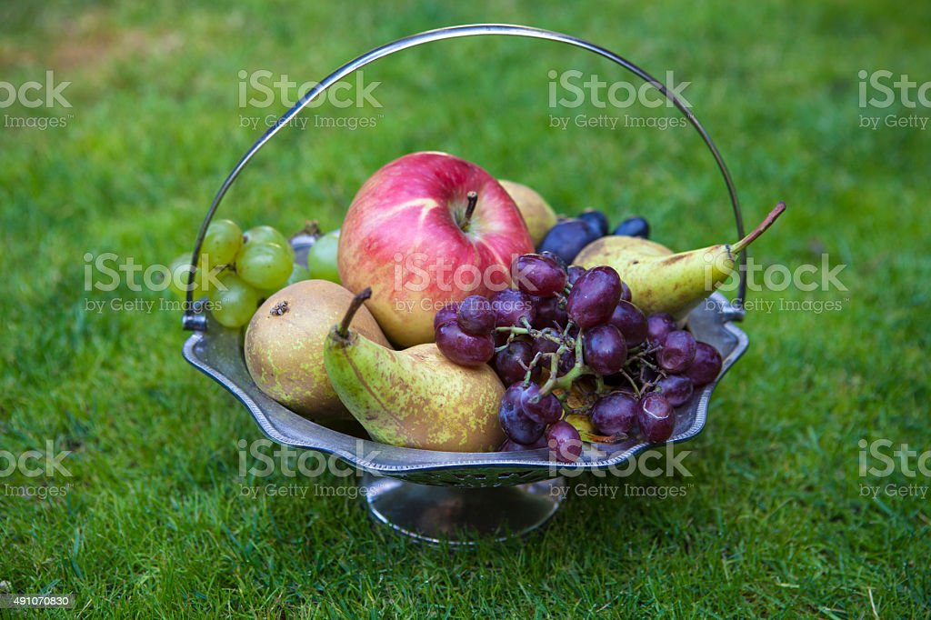 Silver vase with fruit stock photo