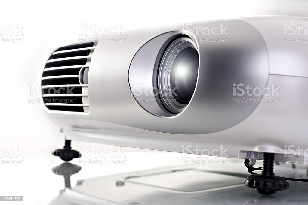 Silver video projector on white table  stock photo