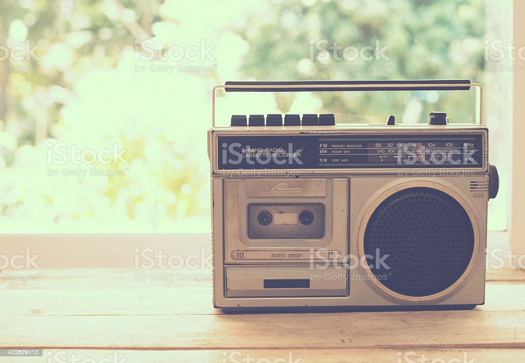 Silver vintage cassette radio on wood shelf stock photo