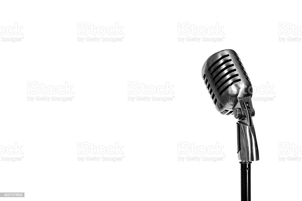 Silver vintage microphone in the studio on white background stock photo