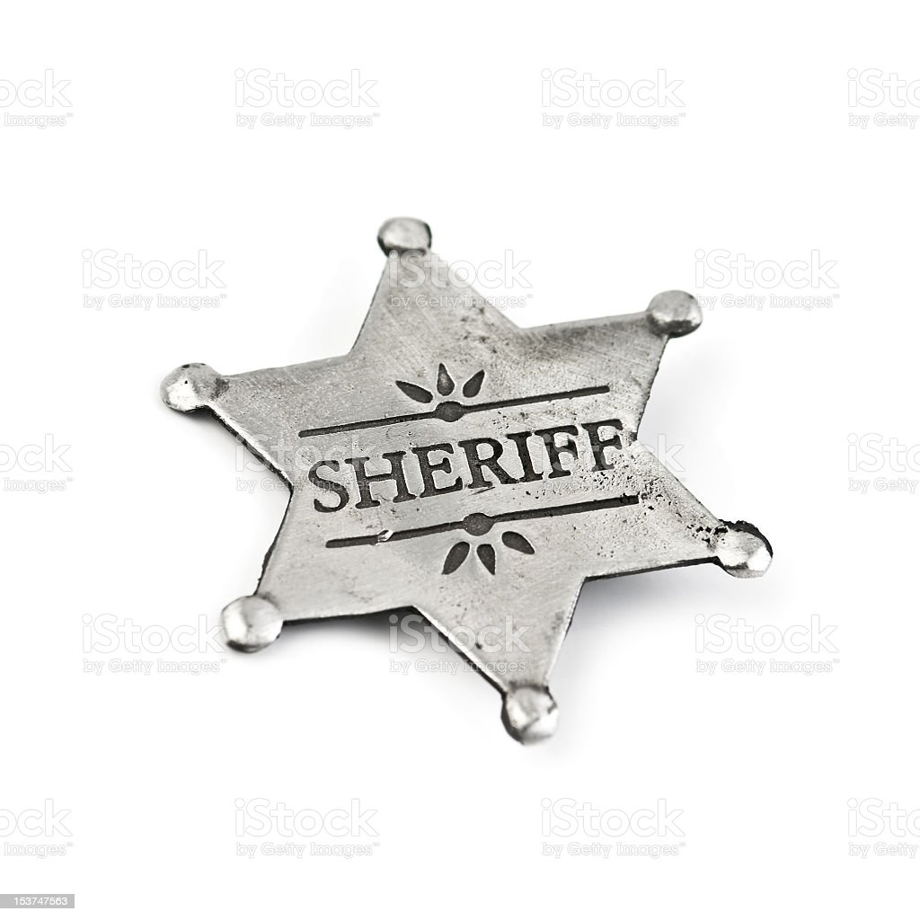 Silver vintage sheriffs badge isolated on a white background stock photo