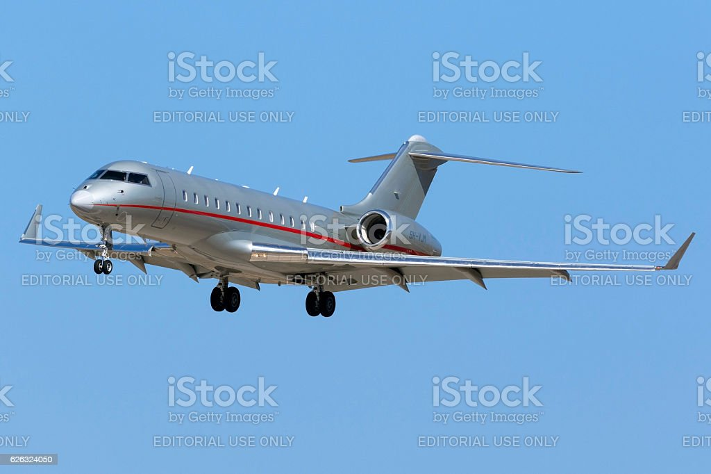 Silver Vistajet BD-700 landing in the summer sun stock photo