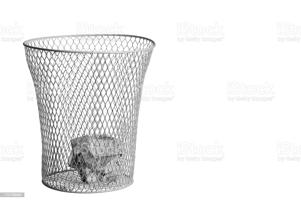 A silver waste rubbish bin with crumbled paper stock photo
