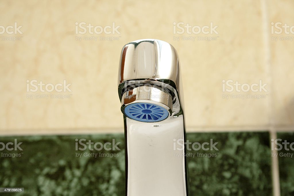 Silver Water Tap in the Bathroom stock photo