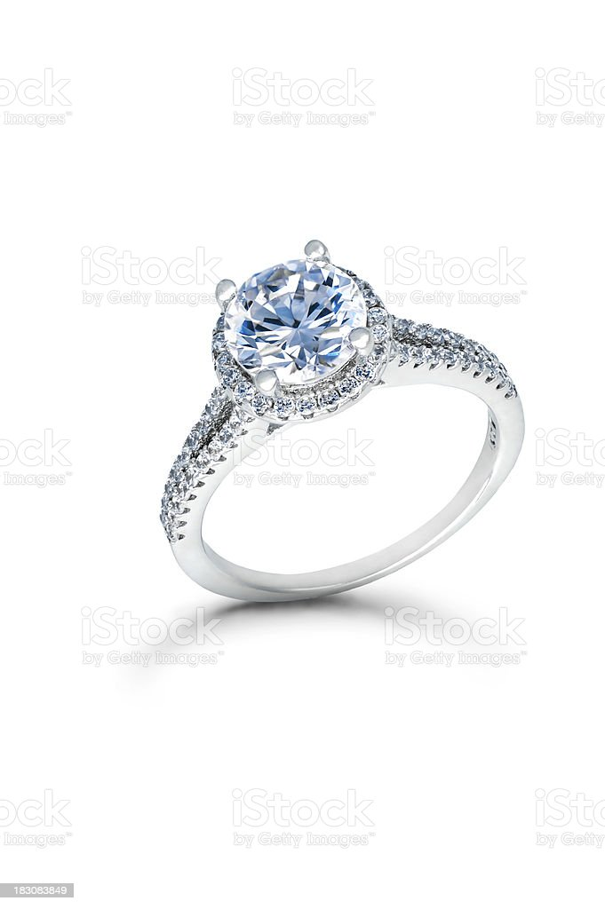 Silver Wedding or Engagement Ring with Blue Diamonds stock photo