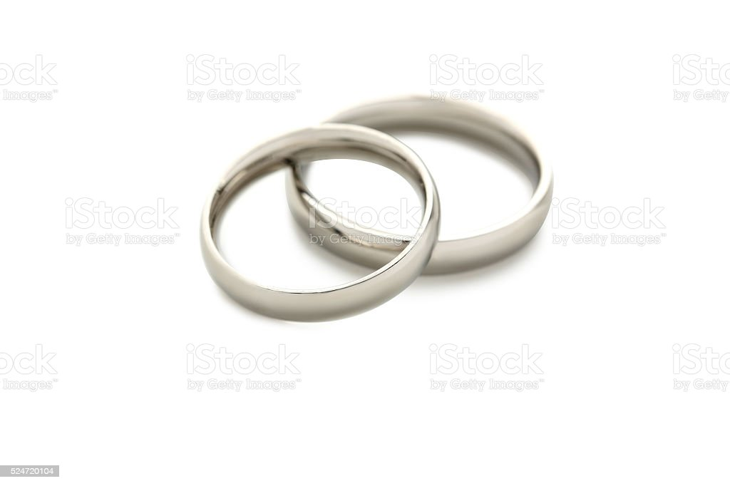 Silver wedding rings isolated on a white stock photo