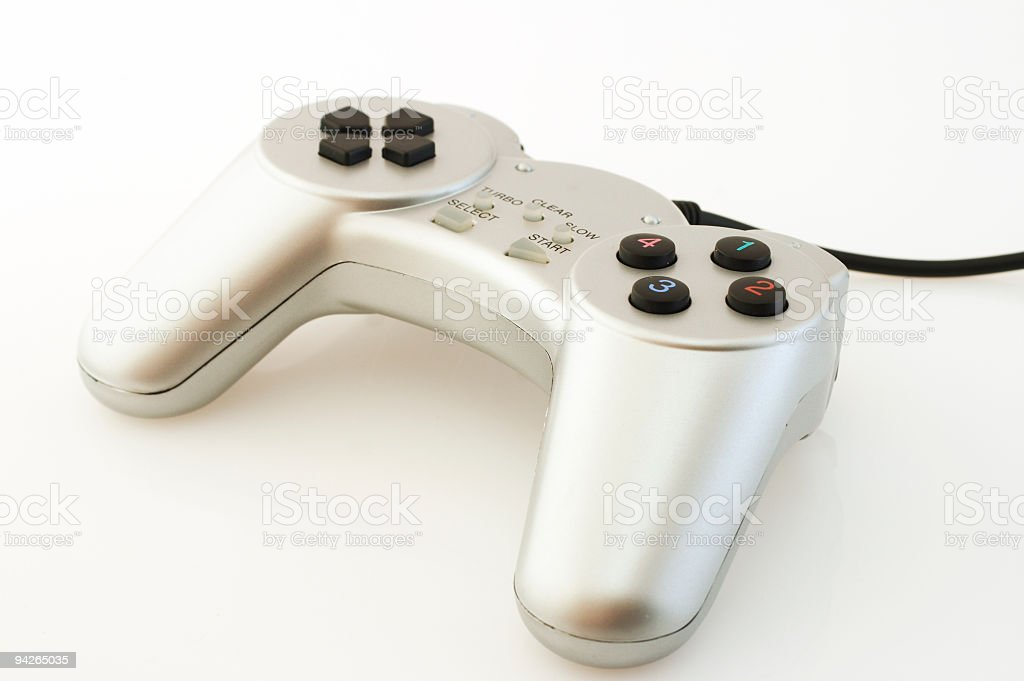 Silver wired gamepad on white background royalty-free stock photo