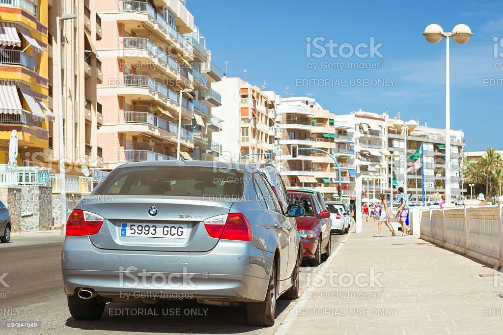 silver-metallic modern car BMW 3-series on sunny street stock photo