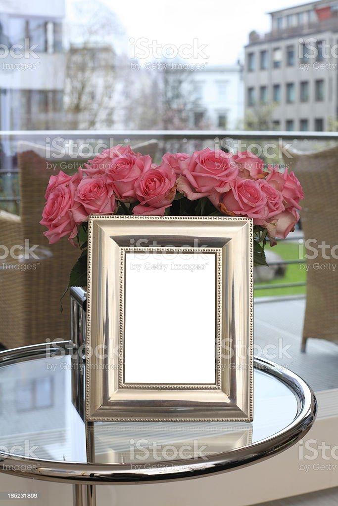 silver-plated picture frame with roses royalty-free stock photo